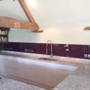 darker coloured glass splashbacks aubergine colour kitchen