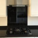 darker coloured glass splashbacks black kitchen