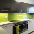 brightly coloured glass splashbacks lime green kitchen