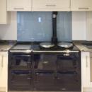 Metallic and Sparkle coloured glass splashbacks - Silver blue metallic glass splashback behind an aga kitchen