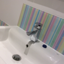 pale pastel stripes behind a sink