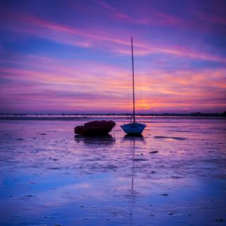 Setting Sun Behind Dorset Boats